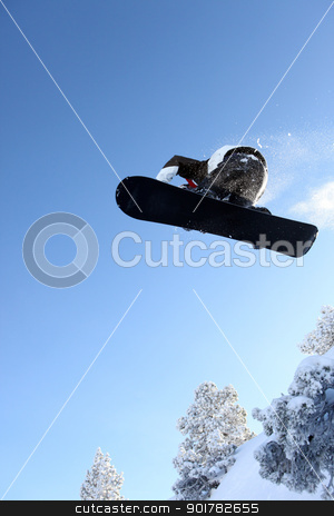 Male snowboarder performing trick stock photo, Male snowboarder performing trick by photography33