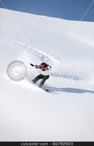 A snowboarder floating down a mountain stock photo, A snowboarder floating down a mountain by photography33