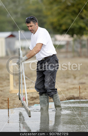 Construction worker using a technical tool stock photo, Construction worker using a technical tool by photography33