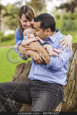 Happy Mixed Race Family Enjoying The Park stock photo, Happy Mixed Race Family Enjoying The Park Together. by Andy Dean