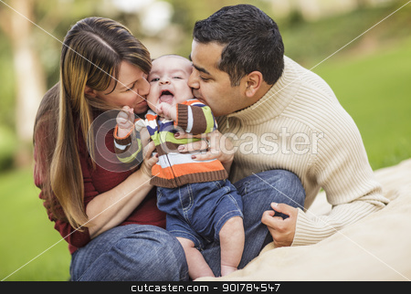 Happy Mixed Race Parents Playing with Their Son stock photo, Happy Mixed Race Parents Playing with Their Giggling Son. by Andy Dean