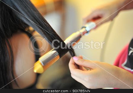Bride Hairdo stock photo, Close up on bride wedding hairdo with electric hair curler by szefei