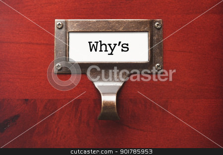Lustrous Wooden Cabinet with Why's File Label stock photo, Lustrous Wooden Cabinet with Why's File Label in Dramatic LIght. by Andy Dean