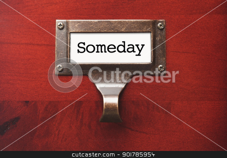 Lustrous Wooden Cabinet with Someday File Label stock photo, Lustrous Wooden Cabinet with Someday File Label in Dramatic LIght. by Andy Dean
