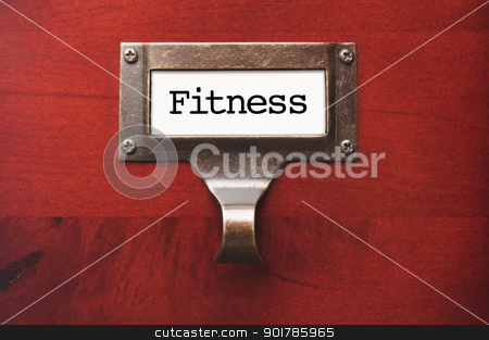 Lustrous Wooden Cabinet with Fitness File Label stock photo, Lustrous Wooden Cabinet with Fitness File Label in Dramatic LIght. by Andy Dean