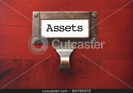 Lustrous Wooden Cabinet with Assets File Label stock photo, Lustrous Wooden Cabinet with Assets File Label in Dramatic LIght. by Andy Dean