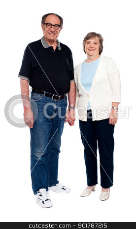 Casual love couple holding hands stock photo, Casual love couple holding hands. Full length portrait by Ishay Botbol