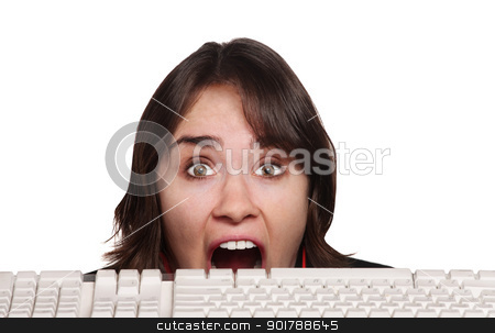 Scared Person and Keyboard stock photo, Scared European woman behind keyboard over white background by Scott Griessel