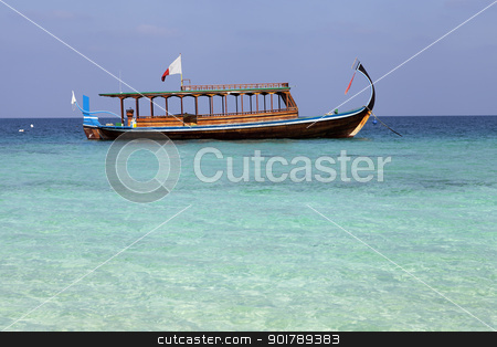Maldivian fishing boat stock photo, Maldivian fishing boat anchored in shallow water by Abdul Sami Haqqani
