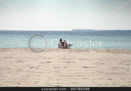 Worshiping the sun stock photo, Sunbather on a beach in the Maldives by Abdul Sami Haqqani