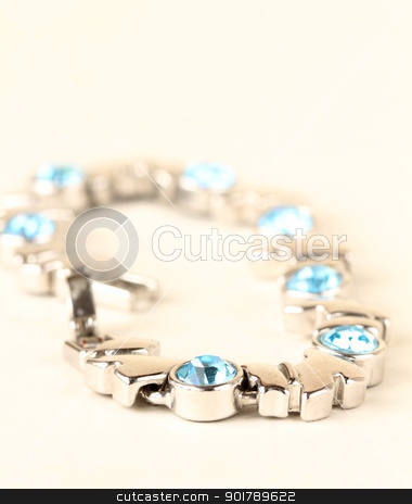 Bracelet in white gold with topaz, soft focus in the foreground stock photo, Bracelet in white gold with topaz, soft focus in the foreground by Olga Kriger
