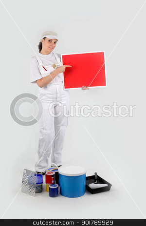Woman painter showing red cardboard stock photo, Woman painter showing red cardboard by photography33