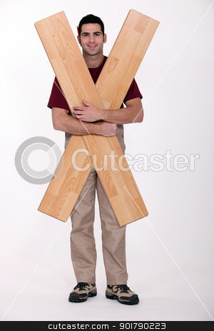 Carpenter with floorboards stock photo, Carpenter with floorboards by photography33