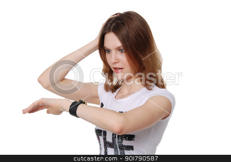 The girl looks at the watch stock photo, The girl looks at the watch isolated on white background by Vadim