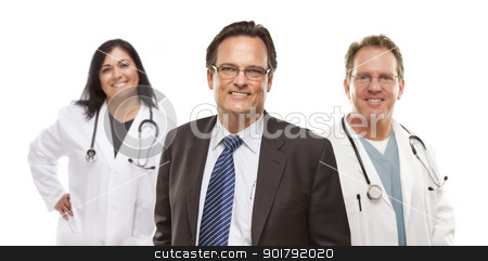 Businessman with Medical Personnel Behind stock photo, Handsome Businessman with Medical Female and Male Doctors or Nurses Behind Isolated on White. by Andy Dean