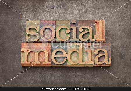 social media in wood type stock photo, social media - internet networking concept - text in vintage letterpress wood type against grunge metal surface by Marek Uliasz