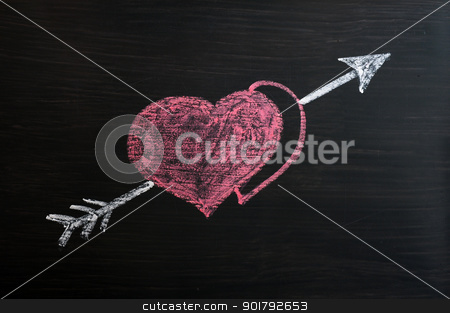 Love hearts with Cupid arrow on a chalkboard  stock photo, Love hearts with Cupid arrow drawn on a chalkboard  by John Young