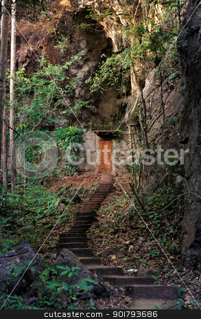 door into the mountain stock photo, cabin door built into side of mountain by Phil Morley