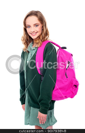 School girl carrying bag on shoulders stock photo, Studio shot of school girl carrying bag on shoulders. All on white background by Ishay Botbol