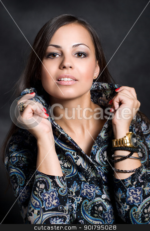 Portrait of beautiful young girl stock photo, Portrait of beautiful young girl against a dark background by Vadim