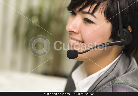 Attractive Young Mixed Race Woman Smiles Wearing Headset stock photo, Attractive Young Mixed Race Woman Smiles Wearing Headset in Office Setting. by Andy Dean
