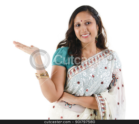 Product here stock photo, Cheerful traditional Asian Indian woman arm out showing empty space, isolated on white by szefei