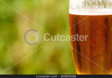 cold glass of beer with foam  stock photo, cold glass of beer with foam with space for text by Artush