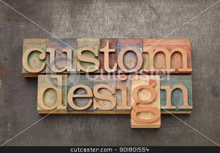 custom design  stock photo, custom design - text in vintage letterpress wood type against grunge metal surface by Marek Uliasz
