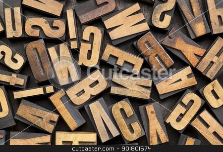 vintage wood type background stock photo, vintage letterpress wood printing blocks placed randomly on a grunge metal tray by Marek Uliasz