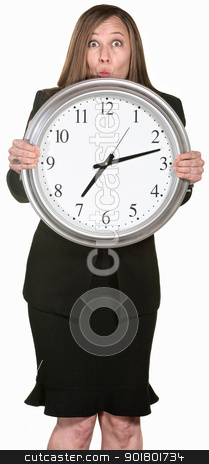 Excited Businesswoman Holding a Clock stock photo, Excited businesswoman behind large clock over white background by Scott Griessel