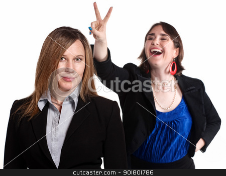 Rabbit Ears Gesture stock photo, Professional woman holds rabbit ears gesture over a worker by Scott Griessel