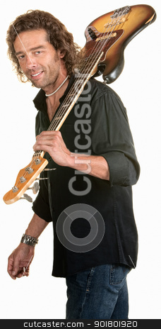 Sexy Guitar Player Over White stock photo, Handsome man holds a guitar over his shoulder by Scott Griessel