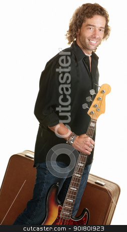 Traveling Musician with Guitar stock photo, Smiling musician holding guitar and brown suitcase by Scott Griessel