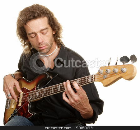 Young Guitar Player stock photo, Young Caucasian man looking down while playing a guitar by Scott Griessel
