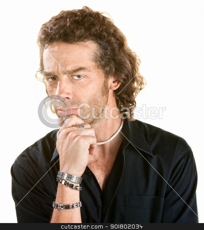 Man With Hand on Chin stock photo, Caucasian male in black shirt with hand on chin by Scott Griessel