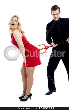 Evil guy poking sensual woman in red stock photo, Evil guy poking sensual woman in red. all on white background by Ishay Botbol