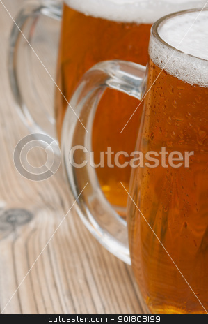 Beer Glasses stock photo, Close-up of Glasses of Beer on Old Wooden Table  by JAMDesign