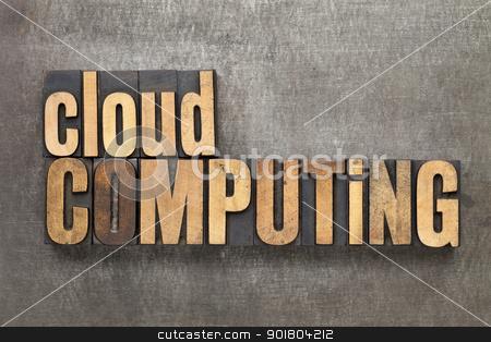 cloud computing stock photo, cloud computing - text in vintage letterpress wood type against a grunge metal sheet by Marek Uliasz