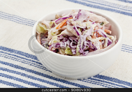 coleslaw side dish stock photo, bowl of coleslaw salad - side dish on a tablecloth by Marek Uliasz