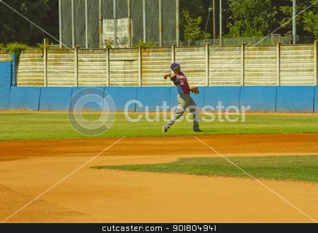 Baseball game stock photo, NOVARA, ITALY - JULY 7: Baseball game Novara (blue)-Bologna (purple) 1-17, Italian Serie A. Bologna right fielder Claudio Liverziani throws the ball. July 7, 2012 by Fabio Alcini