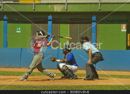 Baseball game stock photo, NOVARA, ITALY - JULY 7: Baseball game Novara (blue)-Bologna (purple) 1-17, Italian Serie A. Bologna center fielder Leonardo De Donno hits a ball. July 7, 2012 by Fabio Alcini