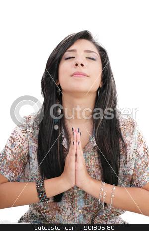 Closeup portrait of a young caucasian woman praying  stock photo, Closeup portrait of a young caucasian woman praying  by dacasdo
