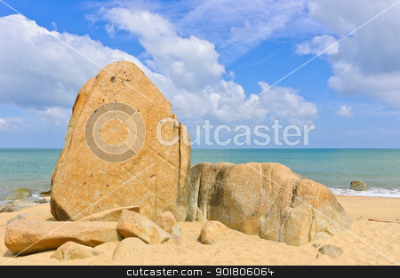 Big rocks on beach stock photo, Rocks on beach with blue sky, Gulf of Thailand coast  by boonsom