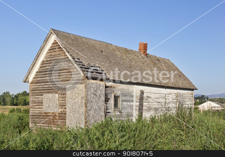 old abandoned farm house stock photo, old abandoned farm house, boarded and overgrown by weeds, near Fort Collins, Colorado by Marek Uliasz