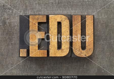 internet domain for education stock photo, dot edu - internet domain for education in vintage wooden letterpress printing blocks on a grunge metal sheet by Marek Uliasz