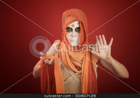 Woman on a Halloween Costume stock photo, Thin woman wearing ghost costume for All Souls Day by Scott Griessel