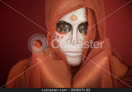 Day of the Dead stock photo, A lady with dramatic All Souls Day makeup and a orange scarf by Scott Griessel