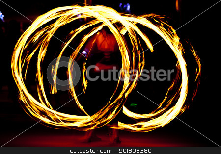 Firedancer stock photo, Fire dancer at night turning torch by Anatoliy Nykilchyk
