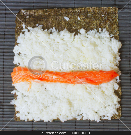 Sushi stock photo, Detail of preparation of sushi: roll of salmon over the rice by Fabio Alcini