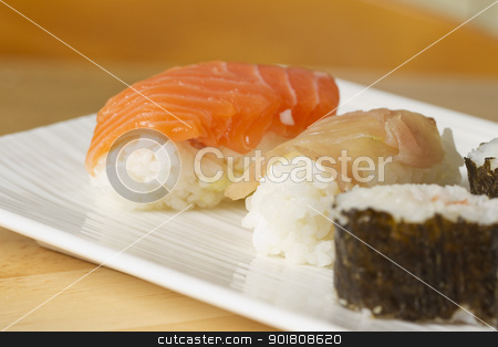 Sushi stock photo, White plate with different kind of sushi  by Fabio Alcini